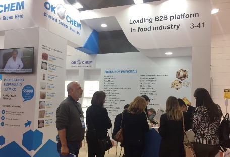 okchem booth with visitors.jpg